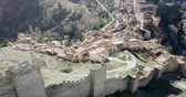 бастион : Defensive Northern wall of Albarracin on background of cityscape with Cathedral tower, Aragon, Spain Стоковые видеозаписи