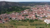 csempézett : Aerial view of small Spanish city of Soria on background of picturesque landscape with river and green hills