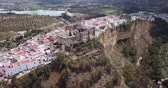 csempézett : Aerial view of Arcos de la Frontera city with medieval castle on edge of cliff