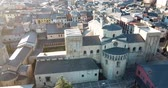 torre sineira : View from drone of medieval Cathedral of la Seu dUrgell and residential area of city in sunny winter day, Catalonia, Spain