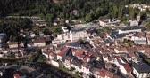 molas : Aerial view of small French town of Ax-les-Thermes on banks of mountain river of Ariege on summer day
