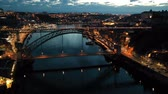 watercourse : Night aerial view of Dom Luis I Bridge over Douro river against backdrop of lighted Porto city, Portugal