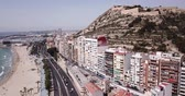 alicante : ALICANTE, SPAIN - APRIL 17, 2019:  Picturesque panorama of coastal area of Spanish town of Alicante overlooking of Port