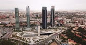 madryt : MADRID, SPAIN - JUNE 16, 2019: Aerial cityscape of Madrid with four modern business skyscrapers Cuatro Torres