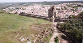 fellegvár : Panoramic view from drone of the castle Montemor o Novo. The Alcaides palace ruins. Evora district. Alentejo, Portugal Stock mozgókép