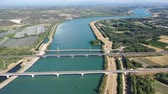 watercourse : Picturesque aerial view of Rhone river with three bridges near small town Roquemaure in Gard department of southern France