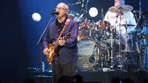 mito : BARCELONA, SPAIN - APRIL 26, 2019:  Mark Knopfler during performance at Palau Sant Jordi, Barcelona Filmati Stock