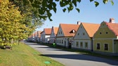 benzer : View of rural street in typical Czech village of Holasovice with similar houses built in South Bohemian Folk Baroque style Stok Video