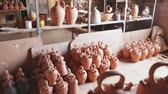 cruche : Handmade jugs from baked clay on shelf in pottery workshop