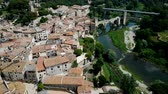 romanesk : View from drone of medieval Spain town of Besalu with Romanesque bridge over Fluvia river