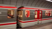 praga : PRAGUE, CZECH REPUBLIC - OCTOBER 13, 2019: View of modern train arriving at Hloubetin station in Prague Metro Wideo