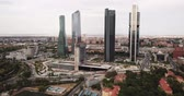 район : MADRID, SPAIN - JUNE 16, 2019: High view of four modern business skyscrapers (Cuatro Torres) in Madrid, Spain Стоковые видеозаписи