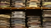 verificador : Large assortment of shirts displayed on shelves in men clothes shop Stock Footage