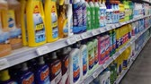 produtos químicos : BARCELONA, SPAIN - NOVEMBER 7, 2019: Various liquid detergents in bottles on supermarket shelves Stock Footage