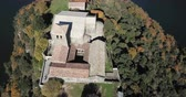 Aerial view of Sant Pere de Casserres monastery on Ter river in autumn, Spain