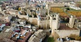 Picturesque autumn landscape of Olite with imposing medieval Palace of Kings of Navarre, Spain