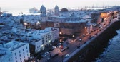 Panoramic view of illuminated Cadiz port city with medieval Cathedral at dawn, Spain