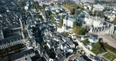 View from drone of French city of Blois with Royal Chateau and church of St. Nicolas in sunny autumn day