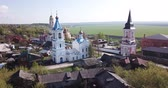 Scenic cityscape of Belyov town located on Oka river overlooking residential areas and church steeples in sunny spring day, Russia