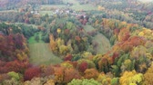 Scenic aerial view of autumn hilly landscape with colored trees