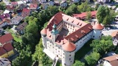 Aerial view of impressive medieval Gewerkenegg Castle in small Slovenian township of Idrija on sunny autumn day 影像素材