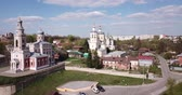 restoring : View of medieval Trinity Cathedral with typical for old Russia architecture tent-like belfry during restoration on background with picturesque Serpukhov cityscape