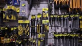 agd : BARCELONA, SPAIN - OCTOBER 22, 2019: Hammers, spanners, wrenches, screwdrivers and other tools on stand in store Wideo