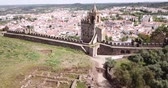 防衛 : Panoramic view from drone of the castle Montemor o Novo. The Alcaides palace ruins. Evora district. Alentejo, Portugal 動画素材