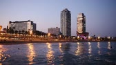 Evening view of new seaside of Barcelona - center of nightlife. Catalonia, Spain