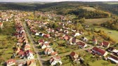 Autumnal aerial landscape of czech village Ostrov u Macochy in autumn day