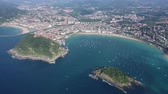 Scenic view from drone of Spanish town of San Sebastian (Donostia) on southern coast of Bay of Biscay on sunny summer day, Basque Country