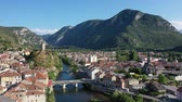 kırmızımsı : General aerial view of small French town of Tarascon-sur-Ariege in valley of Pyrenees on banks of Ariege river on summer day Stok Video
