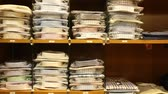paketlenmiş : Large assortment of shirts displayed on shelves in men clothes shop Stok Video