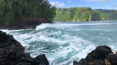 rocky mountains : Waves slowly crashing onto the lava rocks in Maui Hawaii, filmed in high def slow motion Stock Footage