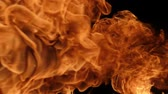 hölle : Slow motion of fire blasts isolated on black background. Filmed on high speed camera, 1000 fps