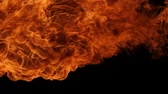 explosão : Slow motion of fire blasts isolated on black background.
