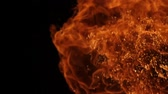 estouro : Slow motion of fire blasts isolated on black background.