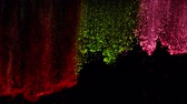 Super slow motion of coloured powder falling on black background. Filmed on high speed cinema camera, 1000 fps. 動画素材