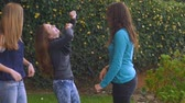 pateta : Teenage girls laughing and playing outside in slow motion