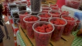 amoras : Fresh raspberries, blueberries, and blackberries for sale at a farmers market in plastic containers