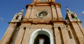 céu claro : Tilt up low angle of the clock tower of the church of our lady of Guadalupe Puerto Vallarta, Mexico