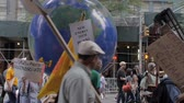 protester : NEW YORK CITY, UNITED STATES - SEPTEMBER 21, 2014 - Protestors pulling a rotating earth at the Peoples Climate March, a large-scale activist event to advocate global action against climate change. Stock Footage