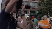 journalist : NEW YORK CITY, UNITED STATES - SEPTEMBER 21, 2014 - A photographer or journalist taking photos with a camera at a protest at the Peoples Climate March, a large-scale activist event to advocate global action against climate change.