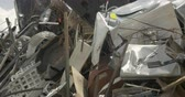 atma : Large pile of scrap metal, broken, and discarded appliances at a junkyard, landfill, or recycling center - dolly shot