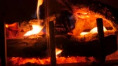 ateş : A jib shot of a wood burning fireplace at night in the living room of a house
