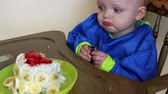 bebês : a baby boy eating choclate cake for his first birthday Stock Footage