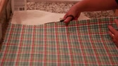 konular : a woman cuts fabric with scissors for advent calendar