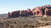 sal : Hikers walking around north and south window arch in beautiful Arches National Park in the desert of Southern Utah
