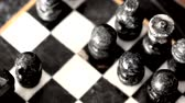 cavaleiro : Playing with a beautiful marble chess set.  Dolly Shot Stock Footage