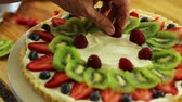 масло : baker making a fresh berry fruit tart desert crust
